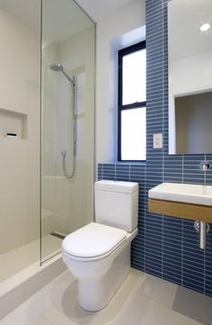 The second bathroom in this Chelsea apartment does not have a window in the shower but uses the same details and materials as the first bathroom.