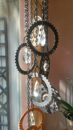 Wind Chimes. What do you do with old car gears and chandelier crystals? Make wind chimes of course!