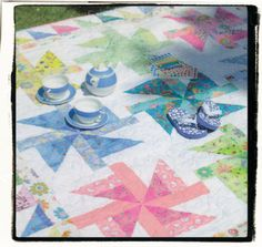 Birthday Gift from Jelly Roll Inspirations Quilt.  Love the fabric used for each block