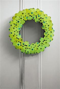 eight dozen glow-in-the-dark rubber eyeballs,12-inch foam wreath form,Wrap the form in black crepe streamers and secure with straight pins. Poke a hole in the back of one eyeball with the sharp end of a flatheaded pin; then insert the pin's flat end into the hole. Using a thimble to protect your finger, press the pin halfway in. Push the sharp end of the pin into the form.