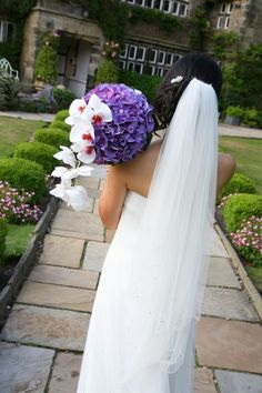 purple hydrangea and white orchids wedding bouquet