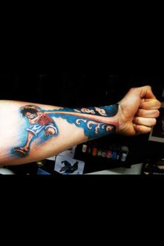 "Clever tattoo - Monkey D. Luffy is a ""rubber man"" in the popular One Piece anime, and this tattoo really makes his arm look like it's stretching out to become this person's full-size fist!  Pow!"