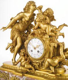 A Fine Louis XVI Style Gilt-Bronze and Fleur De Pêcher Marble Mantle Clock. Paris, late 19th century.