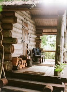 Logs for the fireplace in the porch...bluepueblo:Cabin Porch, Big Sky, Montana photo via randee