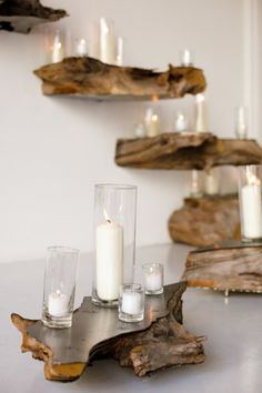 Amazing use of rustic wood--maybe even petrified wood--as shelves with candles. Wouldn't want to get wax on the wood though! Go with Candle Impressions Flameless Candles