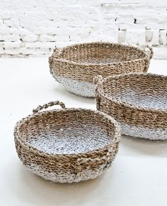 Love the rustic feeling of these bread baskets against the #white brick wall.