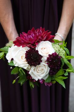 Fall inspired bridesmaid bouquet with white roses, red dahlias, burgundy zinnias, and green mint.