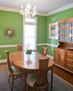 two tone dining room with chair rail light color abovedark