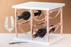 If your storage options are limited but your wine collection is not, then this DIY is for you. Put your wine collection on display and keep your favorite bottles on hand for entertaining with an...