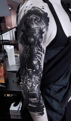 Tattoo Arm, Gas Mask, Portrait Of Man - http://tattootodesign.com/tattoo-arm-gas-mask-portrait-of-man/ | #Tattoo, #Tattooed, #Tattoos