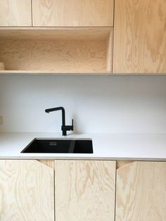 like the edge cut for the door handle. Can make it very small kitchen design plywood pine black kitchen tap Kitchen Door Designs, Kitchen Doors, Modern Kitchen Design, Interior Design Kitchen, Pine Kitchen, Kitchen Ideas, Black Kitchen Taps, Black Kitchens, Home Kitchens