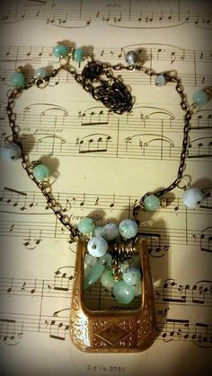 Chalcedony, larimar, aquamarine, & amazonite adorn brass chain & belt buckle. These are rare & quality stones! Perfect for the cowgirl in your life! https://www.facebook.com/pages/Take-II-Vintage-Treasures-Upcycled-Jewelry/276500575881676