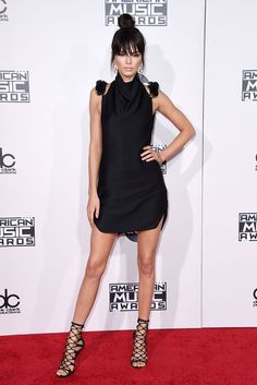Kendall Jenner debuts bangs (!) on the 2015 American Music Awards red carpet. Click through to see all the #AMAs looks.