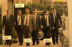 The Bonanno Crime Family members walk. Federal witness Frank Lino in a grey suit.