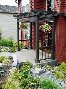 Front Door Landscape Design | An arbor gives interest to this previously uninspired front porch.
