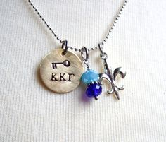 KAPPA KAPPA GAMMA Handstamped Gold Brass Key Charm Necklace with Light and Dark Blue Crystals, Silver Plated Fleur-de-lis charm on Etsy, $18.00