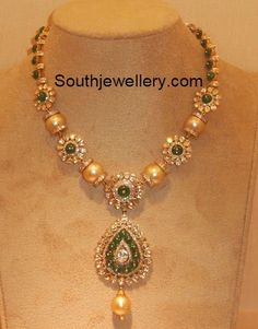 Simple and stylish floral motifs diamond necklace strung with south sea pearls and studded with small polki diamonds and green jades.