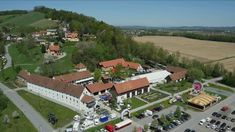 Stock video footage Aerial shot of a church and roads in the German town Höfen an der Enz. Camera pans right moving past the church, and then rotates to the right until back of church is in view. German Village, Stock Video, Stock Footage, Dolores Park, Stock Photos, Cave, Nature, Lawn And Garden, Switzerland