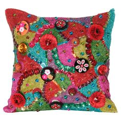 Exotic woven pillow, showcasing eye-catching beaded accents and a vibrant multicolor palet.
