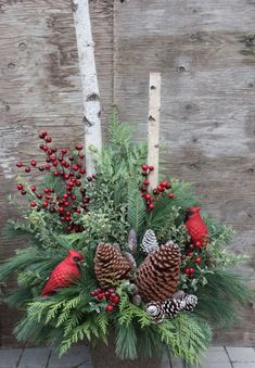 Winter urn arrangement with pinecones, red berries and cardinals. Perfect for Christmas outdoor urn arrangement. by brendaq