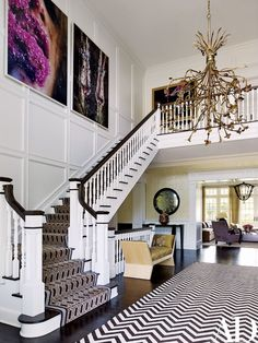 Contemporary staircase by Juan Montoya Design, vintage chandelier from Historical Materialist hangs in the entrance hall, the two large photographs are by Marilyn Minter, and the stair runner is by Patterson Flynn Martin. Design Entrée, House Design, Interior Design, Interior Architecture, Architectural Digest, New York Homes, New Homes, Staircase Runner, Stair Runners