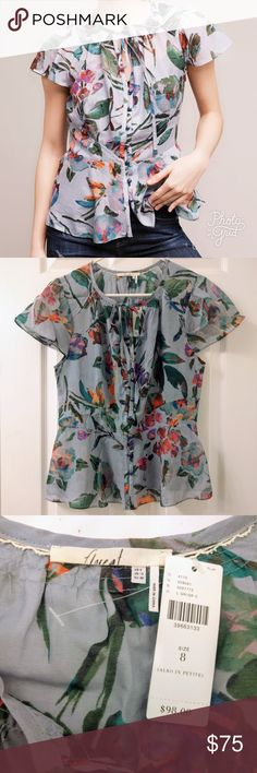Floreat Amarillo Cinch-Waist top Bold but feminine cotton/silk blouse from Anthropologie. Colorful floral print on a soft grey.  Pretty little buttons and a tie-neck, cinched-waist in the back. Slight peplum style and flowy sleeves. Machine wash! Anthropologie Tops Blouses