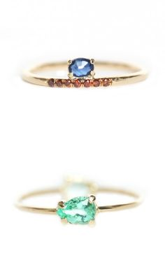 I'm obsessing over these rings by Caitlin Mociun, especially that bright blue sapphire.