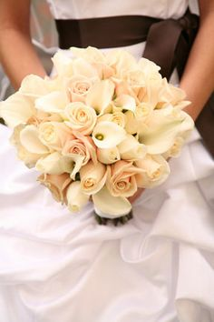 Calla lillies and roses.  Imagine in all white, instead of blush
