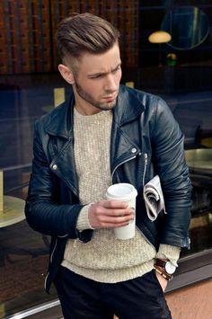 black leather jacket. rock style.  beige sweater. wool. black dress pants.