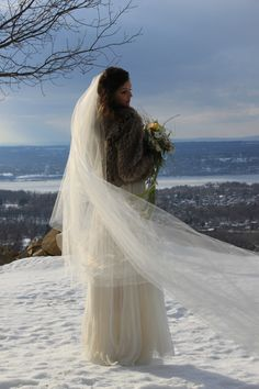 Love this shot! The veil looks so soft floating in the wintry air.