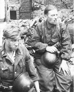 "Two Waffen-SS soldiers of 5th SS Panzer Division ""Wiking"" in ruins of Warsaw , August 1944 #polish #poland #wwii #military #history #insurgency #warsawuprising #militaryhistory #tank #warthunder #warsaw #ukraine #ussr #russia #wehrmacht #luftwaffe #kriegsmarine #ss #waffenss #award #medal #german #germany #deutsch #deutschland #camo #army #panzer FOLLOW THE CREW @_grossdeutschland_ @armor.of.ww2 @ww2.germanstuff @german.ww2.history @hugues_ens @german_ww2_page @german_wars_page @waffen_..."