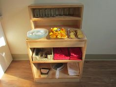 Montessori is all about fostering independence. This beautiful snack hutch presents all the material Montessori Baby, Montessori Homeschool, Montessori Classroom, Montessori Activities, Homeschooling, Baby Activities, Montessori Kindergarten, Montessori Bedroom, Infant Room Daycare