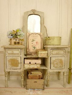 Miniature Chic French Shabby vanity, Distressed Gustavian gray, Collectible furniture in wood for a dollhouse in 1:12th scale   Wooden vanity, 2 functional drawers and 2 doors. 3.5 cm (D) 1.38 X 12 cm (L) 4.72 X 16 cm (H) 6.3.  *** SOLD ALONE. Without decorative accessories.***   — Painting distressed Gustavian gray. — Cristal drawers and doors knobs. — Its mirror is also aged.  It is an essential element of charm from France in a shabby miniature house.    ♥♥♥ You also can see most of my…