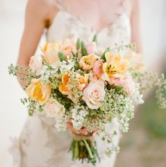 Baby's breath, white roses and lillies?