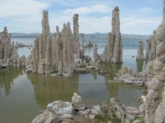 Mono Lake (CA, USA) is highly alkaline due to runoff from the surrounding mountains and the fact that the lake has no outlet other than evaporation. The runoff has a high concentration of calcium carbonate that forms into the tufa towers in and around the lake.
