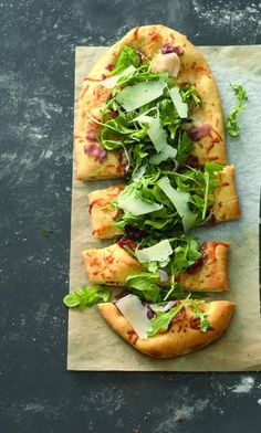 "Prosciutto, Arugula, and Parmesan Pizza – chewy-crisp crust, an enticing cheese blend, and a refreshing ""tossed salad"" on top."