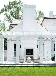 Love this all-white pergola next to a modern Colonial-style home, complete with . Love this all-white pergola next to a modern Colonial-style home, complete with an outdoor fireplace. Outdoor Space, Outdoor Living, Exterior Design, Outdoor Fireplace, Modern Farmhouse Exterior, White Pergola, Modern Colonial, Outdoor Design, Exterior