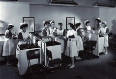 A group of nursing students busy with hands-on training, circa 1945