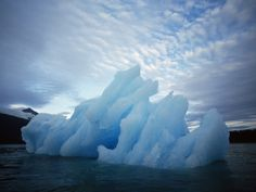 size: Photographic Print: Usa, Alaska, Iceberg Floating on the Water by Jeff Foott : Entertainment Framed Artwork, Wall Art Prints, Poster Prints, Beach Landscape, Photographic Prints, Find Art, Alaska, Scenery, Abstract