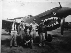 P-40 with Orin Welch, Dick Rossi, Charlie Sharkey, Dick Snell, and Jimmy Fox in Kunming China.   Source: National Archives and Records Administration via San Diego Air and Space Museum.