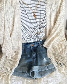 Perfect Casual Summer Outfit with distressed denim shorts, striped shirt and fringe cardigan