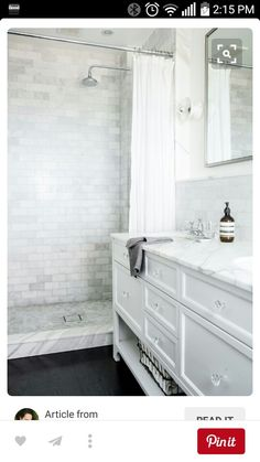 This is my main inspiration bath. Black tile floors, doorless shower, white cabinets with crystal knobs with marble top (judy)
