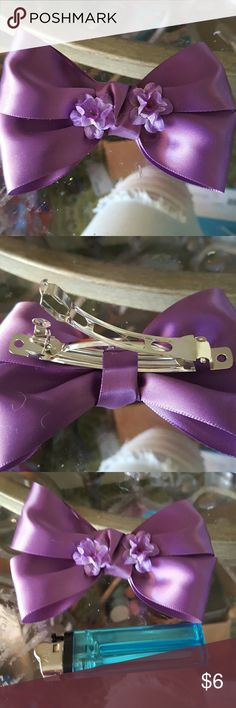 """Handmade bow Handmade purple satin bow w/purple flowers. On a 3"""" barrette. Lighter used for size reference. Great for any occasion. Accessories Hair Accessories"""