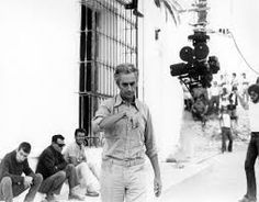 Antonioni preparing the incredibly complicating set-up for the movie's amazing continuous crane shot at the climax.