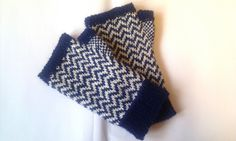 Waterhouse Mitts.  Made these a few months ago.  Very pleased with the results.