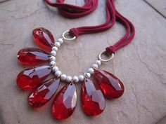 Too pretty...red teardrop crystals and gold crackle beads!