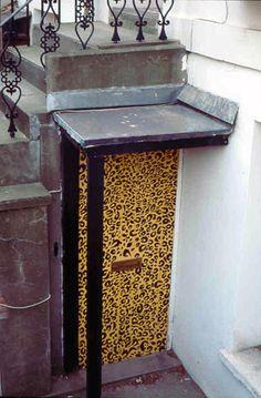 A Leopard skin painted Door in North London Skin Paint, Unique Doors, North London, Painted Doors, Bird Feeders, Entryway Tables, Backyard, Facades, Outdoor Decor