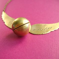 Harry Potter Snitch Necklace omg i want @Erin B B Moon Copeland we need this!