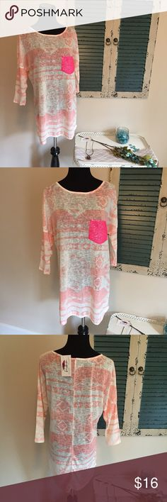 Just in Tribal print top with sequin pocket This adorable top just arrived in and is pink and ivory with a hot pink sequin pocket. High low style and semi sheer with 3/4 sleeves. Smoke free home. Runs true to size. Don't miss out on your size!   https://www.facebook.com/lookingglasslaneboutique/ Voll Tops Blouses
