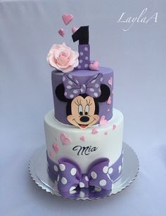 ▷ 1001 + ideas for the cutest Minnie Mouse cake for your little one purple and white fondant, two tier cake, minnie mouse cake decorations, silver cake stand Mickey Mouse Torte, Minni Mouse Cake, Mickey And Minnie Cake, Minnie Mouse Cookies, Bolo Mickey, Mickey Cakes, Minnie Mouse Cupcake Cake, Mini Mouse Birthday Cake, Baby Birthday Cakes